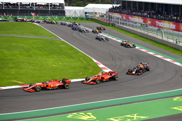 Charles Leclerc, Ferrari SF90, leads Sebastian Vettel, Ferrari SF90, Alexander Albon, Red Bull RB15, Carlos Sainz Jr., McLaren MCL34, Lewis Hamilton, Mercedes AMG F1 W10, and the rest of the field on the opening lap