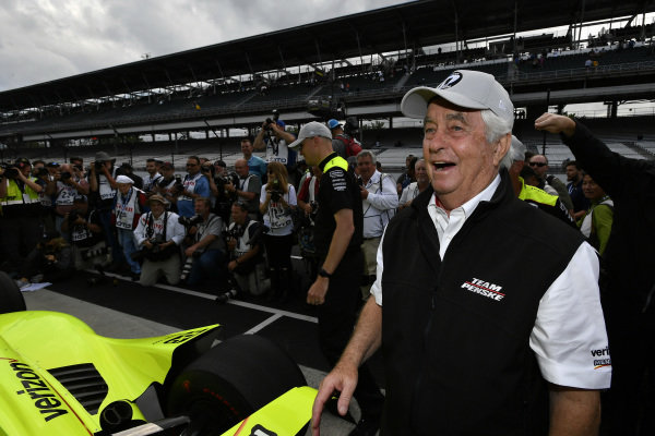Roger Penske celebrates Simon Pagenaud, Team Penske Chevrolet winning the pole