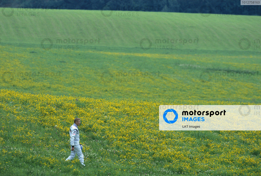 2000 Austrian Grand Prix. A1-Ring, Zeltweg, Austria. 14-16 July 2000. Mika Hakkinen (McLaren Mercedes) faces the lonely walk back to the pits after car failure during practice for the race. Ref-00 AUT A69. A Race Through Time exhibition number 4. World Copyright - Lorenzo Bellanca/LAT Photographic