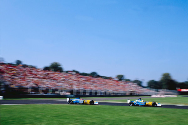 2002 Italian Grand PrixMonza, Italy. 14th - 16th September 2002Jarno Trulli, Renault R202, leads team mate Jenson Button, Renault R202.World Copyright - LAT Photographicref: 35mm Transparency 02_ITA_21