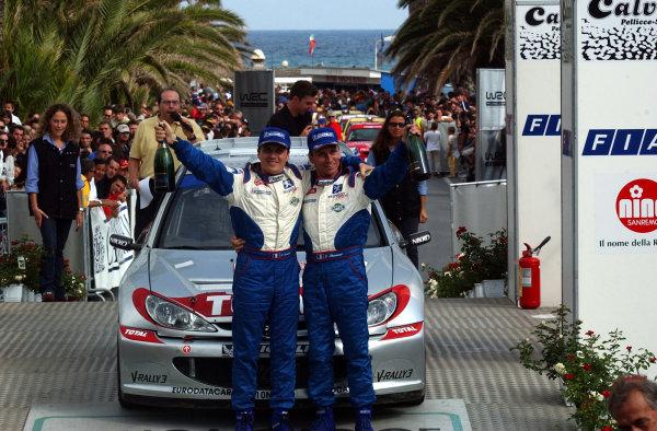 2002 World Rally Championship.Rallye d'Italia, 20-22 September.Sanremo, Italy.Gilles and Herve Panizzi celebrate on the podium.Photo: Ralph Hardwick/LAT