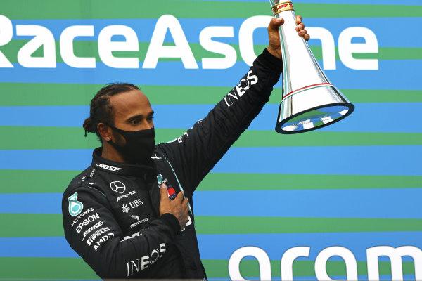 Lewis Hamilton, Mercedes-AMG Petronas F1, raises his winner's trophy