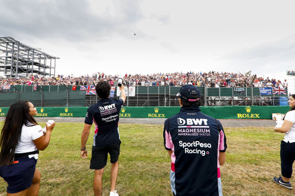 Lance Stroll, Racing Point and Sergio Perez, Racing Point give t-shirts to fans