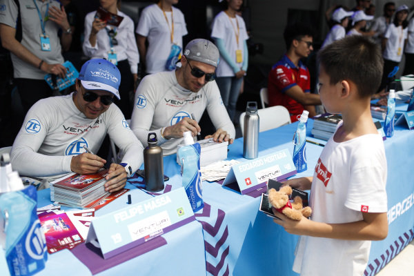 Felipe Massa (BRA), Venturi Formula E, and Edoardo Mortara (CHE) Venturi Formula E, signs autographs