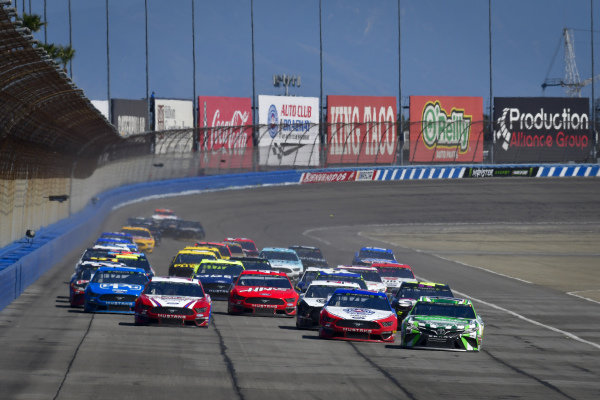 #18: Kyle Busch, Joe Gibbs Racing, Toyota Camry Interstate Batteries and #22: Joey Logano, Team Penske, Ford Mustang AAA Southern California lead the field