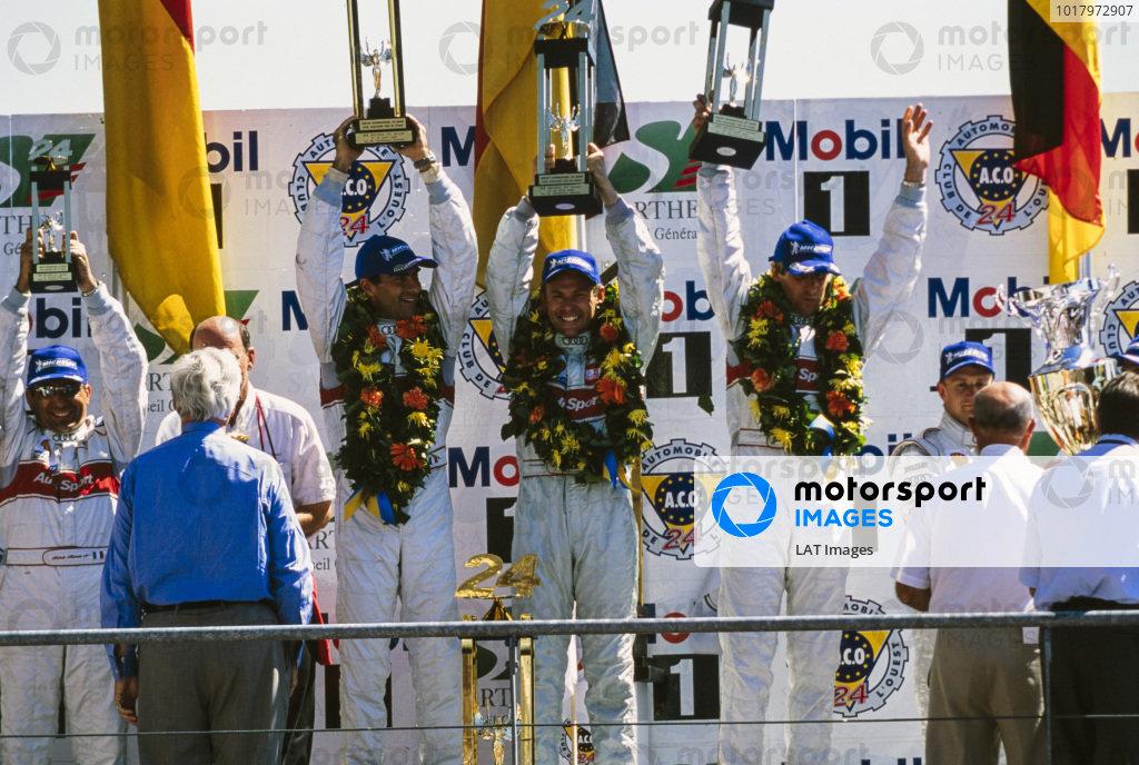 Winners Frank Biela, Emanuele Pirro & Tom Kristensen celebrate on the podium.