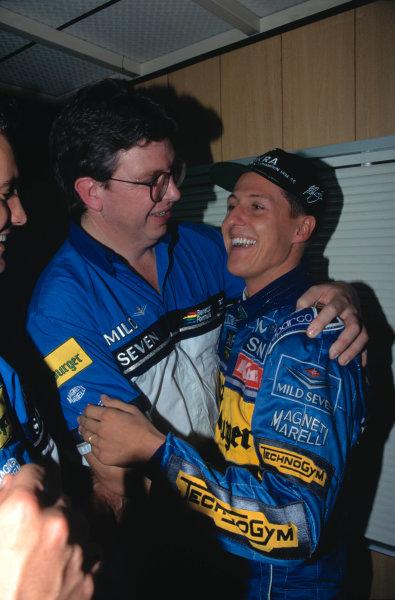 1995 Japanese Grand PrixSuzuka, Japan. 27th - 29th October.Michael Schumacher and Ross Brawn celebrate.World Copyright:LAT PhotographicRef:35mm Image