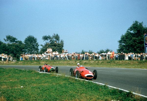 1957 Italian Grand Prix. Monza, Italy.6-8 September 1957.Harry Schell (Maserati 250F) followed by Peter Collins (Lancia-Ferrari 801). Ref-57 ITA 31.World Copyright - LAT Photographic