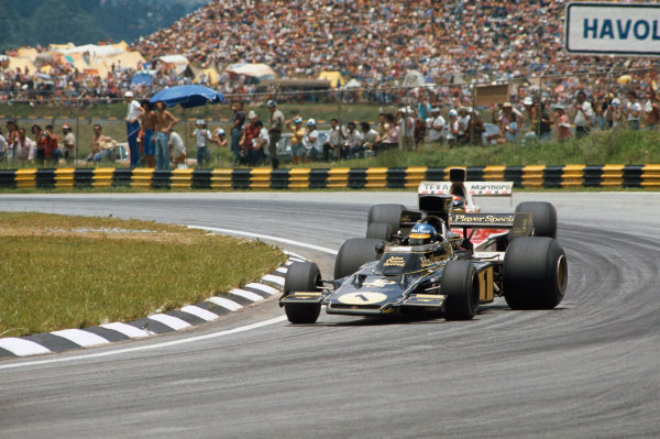 1974 Brazilian Grand Prix  Interlagos, Sao Paulo, Brazil. 25-27th January 1974.  Ronnie Peterson, Lotus 72E Ford, 6th position, leads Emerson Fittipaldi, McLaren M23 Ford, 1st position.  Ref: 74BRA09. World Copyright: LAT Photographic