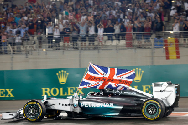 Yas Marina Circuit, Abu Dhabi, United Arab Emirates. Sunday 23 November 2014. Lewis Hamilton, Mercedes F1 W05 Hybrid, celebrates after winning the race and the 2014 Drivers Championship. World Copyright: Alastair Staley/LAT Photographic. ref: Digital Image _79P0850