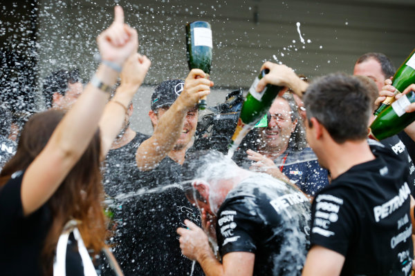 Suzuka Circuit, Japan. Sunday 9 October 2016. Nico Rosberg, Mercedes AMG, 1st Position, and the Mercedes team celebrate with Champagne. World Copyright: Steven Tee/LAT Photographic ref: Digital Image _R3I9185