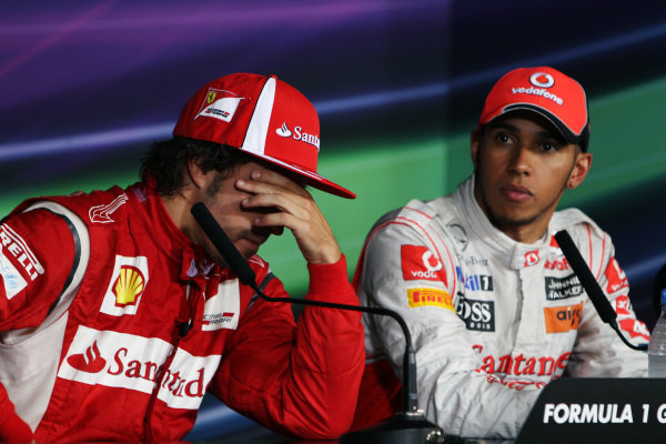 (L to R): Second placed Fernando Alonso (ESP) Ferrari and race winner Lewis Hamilton (GBR) McLaren in the FIA Press Conference. Formula One World Championship, Rd 10, German Grand Prix, Race, Nurburgring, Germany, Sunday 24 July 2011.  BEST IMAGE