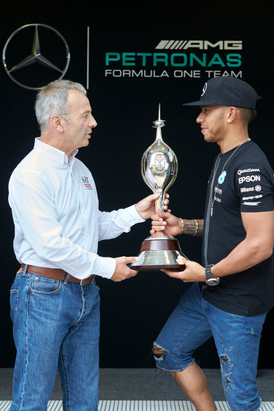 Silverstone Circuit, Northamptonshire, England. Thursday 2 July 2015. Lewis Hamilton, Mercedes AMG is presented with the Mike Hawthorn Memorial Trophy by MSA Chief Executive Rob Jones. World Copyright: Steve Etherington/LAT Photographic ref: Digital Image SNE29205