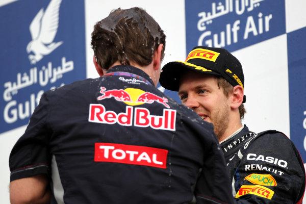 Bahrain International Circuit, Sakhir, Bahrain22nd April 2012Christian Horner, Team Principal, Red Bull Racing, and Sebastian Vettel, Red Bull Racing, 1st position, celebrate on the podium. World Copyright: Andy Hone/LAT Photographicref: Digital Image HONY8726