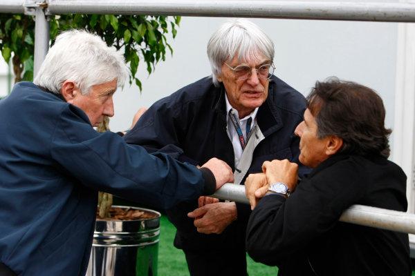 Interlagos, Sao Paulo, Brazil.16th October 2009.Bernie Ecclestone with Herbie Blash, FIA, and Nelson Piquet. Portrait. World Copyright: Charles Coates/LAT Photographicref: Digital Image _26Y9395