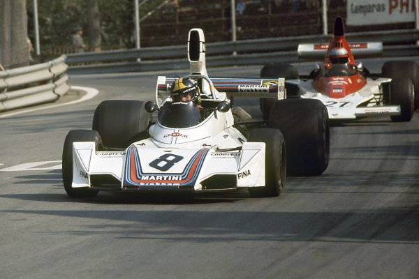 1975 Spanish Grand Prix.Montjuich Park, Spain. 27 April 1975.Carlos Pace, Brabham BT44B-Ford, retired, leads Mario Andretti, Parnelli VPJ4-Ford, retired, action.World Copyright: LAT PhotographicRef: 35mm transparency 75SPA