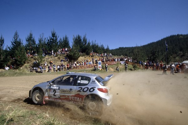 2002 World Rally Championship.New Zealand Rally, New Zealand. 2-5 October 2002.Marcus Gronholm/Timo Rautiainen (Peugeot 206 WRC), 1st position.World Copyright: McKlein/LAT PhotographicRef: 35mm transparency 02RALLY12
