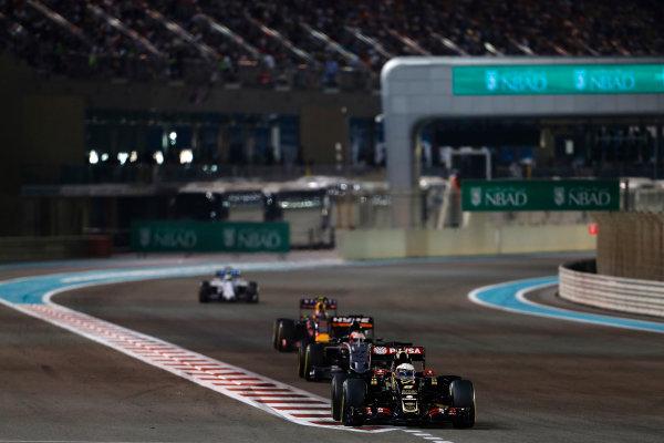 Yas Marina Circuit, Abu Dhabi, United Arab Emirates. Sunday 29 November 2015. Romain Grosjean, Lotus E23 Mercedes, leads Nico Hulkenberg, Force India VJM08 Mercedes. World Copyright: Sam Bloxham/LAT Photographic ref: Digital Image _SBL9159