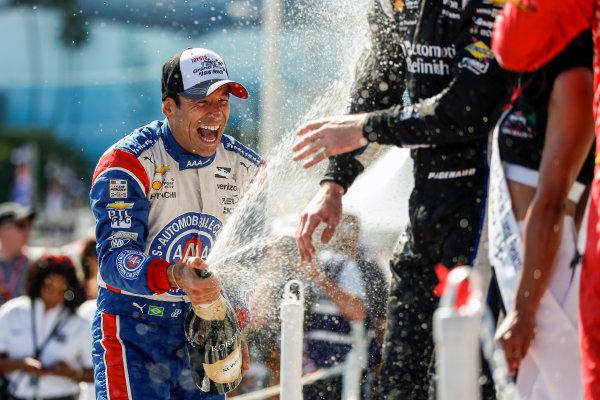15-17 April, 2016, Long Beach, California USA 3 Helio Castroneves celebrates with champagne on the podium ?2016, Sam Cobb LAT Photo USA
