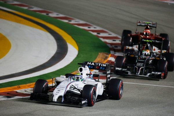 Marina Bay Circuit, Singapore. Sunday 21 September 2014. Felipe Massa, Williams FW36 Mercedes, leads Esteban Gutierrez, Sauber C33 Ferrari, and Kimi Raikkonen, Ferrari F14T. World Copyright: Glenn Dunbar/LAT Photographic. ref: Digital Image _W2Q5511