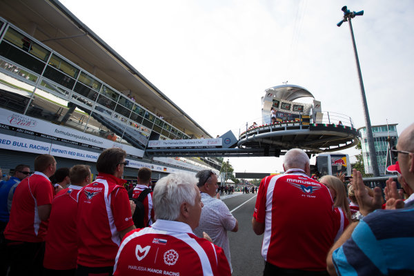 2014 GP3 Series. Round 7.   Autodromo di Monza, Monza, Italy. Sunday 7 September 2014. Some of the Marussia F1 team watch the podium. Dean Stoneman (GBR, Marussia Manor Racing). Photo: Zak Mauger/GP3 Series Media Service. ref: Digital Image _L0U0128