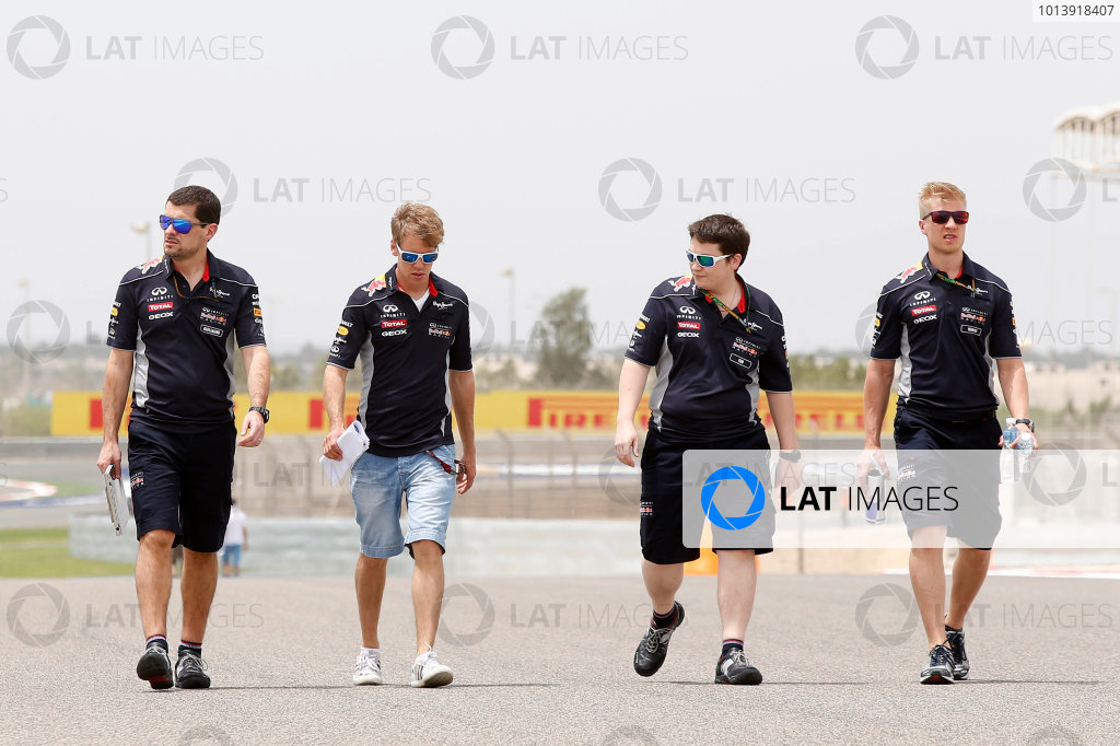 Bahrain International Circuit, Sakhir, Bahrain Thursday 18th April 2013 Sebastian Vettel, Red Bull Racing, walks the track with Red Bull team mates. World Copyright: Charles Coates/LAT Photographic ref: Digital Image _N7T8018