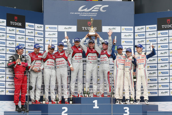 2013 FIA WEC Championship, Silverstone, Northamptonshire. 12th - 14th April 2013. Tom Kristensen / Loic Duval / Allan McNish Audi R18 e-tron quattro celebrate the win on the podium World Copyright: Ebrey / LAT Photographic.