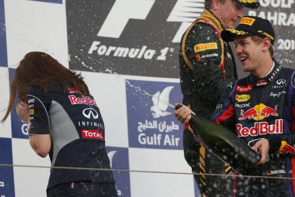 Bahrain International Circuit, Sakhir, Bahrain Sunday 21st April 2013 Sebastian Vettel, Red Bull Racing, 1st position, sprays Waard at Gill Jones, Head of Trackside Electronics, Red Bull Racing, on the podium. World Copyright: Andy Hone/LAT Photographic ref: Digital Image HONZ3108