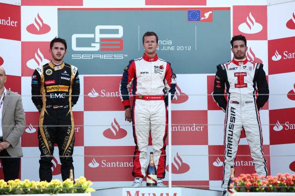 2012 GP3 Series, Round 3.Valencia, Spain. 24th June 2012. Sunday Race 2. (LtoR) 2nd place Daniel Abt (GER, Lotus GP) 1st place Patric Niederhauser (SUI, Jenzer Motorsport) 3rd place Tio Ellinas (CYP, Marussia Manor Racing) on the podium. Portrait. World Copyright:  Daniel Kalisz/LAT Photographic Ref: Digital Image IMG_2093