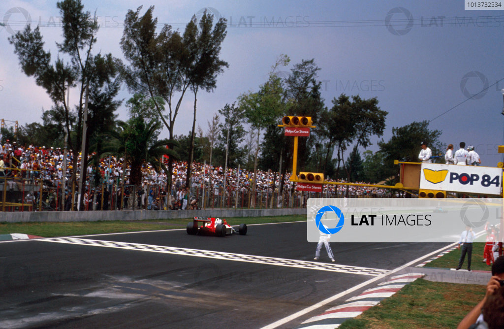 Mexico City, Mexico. 27th - 29th May 1988.Alain Prost (McLaren MP4/4 Honda), 1st position, crosses the line to take the victory, action. World Copyright: LAT Photographic. Ref: 88MEX09