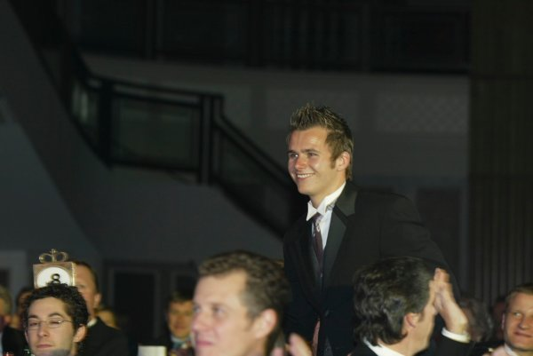 2003 AUTOSPORT AWARDS, The Grosvenor, London. 7th December 2003. Dan Wheldon gets up to accept the award for Rookie of the year. Photo: Peter Spinney/LAT Photographic Ref: Digital Image only