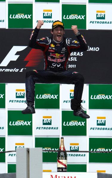 Interlagos, Sao Paulo, Brazil. 27th November 2011. Mark Webber, Red Bull Racing RB7 Renault, 1st position, celebrates victory. Portrait. Podium.  World Copyright: Steve Etherington/LAT Photographic ref: Digital Image SNE28295