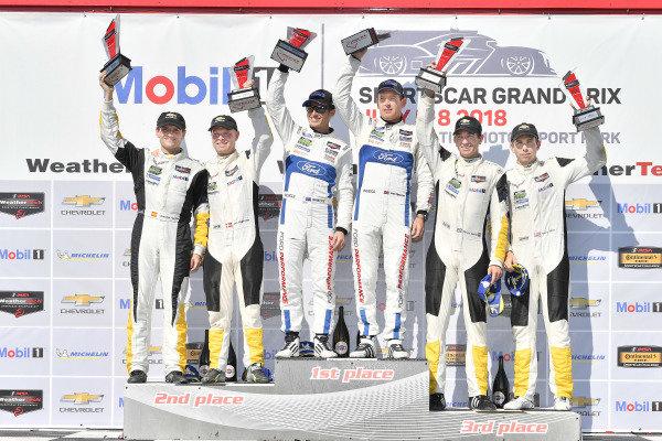 #67 Chip Ganassi Racing Ford GT, GTLM: Ryan Briscoe, Richard Westbrook celebrates the win on the podium with #3 Corvette Racing Chevrolet Corvette C7.R, GTLM: Antonio Garcia, Jan Magnussen, #4 Corvette Racing Chevrolet Corvette C7.R, GTLM: Oliver Gavin, Tommy Milner