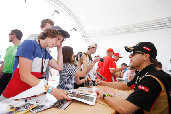 Hockenheimring, Hockenheim, Germany. Saturday 19 July 2014. Pastor Maldonado, Lotus F1, signs autographs for fans. World Copyright: Charles Coates/LAT Photographic. ref: Digital Image _N7T4318