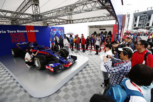 Fans admire a Toro Rosso show car.