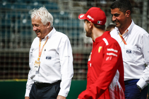 Charlie Whiting, Race Director, FIA, withSebastian Vettel, Ferrari.