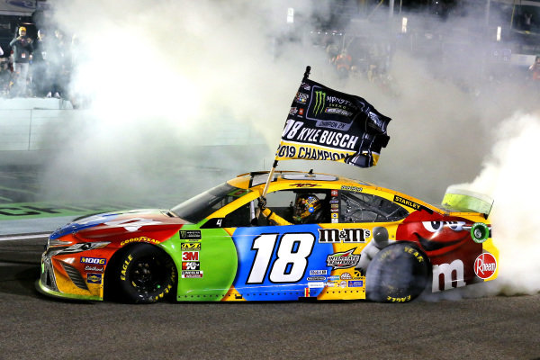 #18: Kyle Busch, Joe Gibbs Racing, Toyota Camry M&M's celebrates his race  and championship wins with a burnout