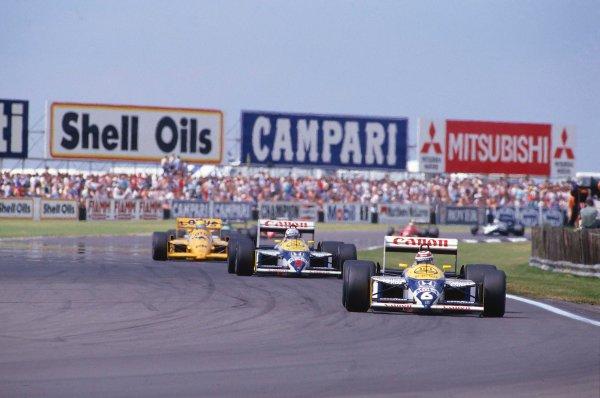 1987 British Grand Prix.Silverstone, England.10-12 July 1987.Nelson Piquet leads Nigel Mansell (both Williams FW11B Honda's) and Ayrton Senna (Lotus 99T Honda).Ref-87 GB 27.World Copyright - LAT Photographic
