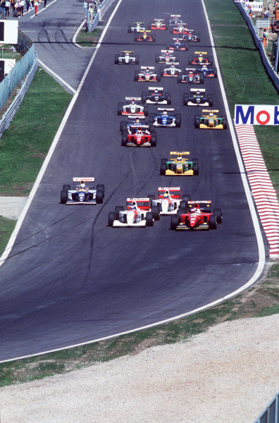 Jean Alesi, Ferrari F93A, battles with Mika Häkkinen, McLaren MP4-8 Ford, into the first corner at the start, as Ayrton Senna, McLaren MP4-8 Ford, leads Alain Prost, Williams FW15C Renault, and Michael Schumacher, Benetton B193B Ford.