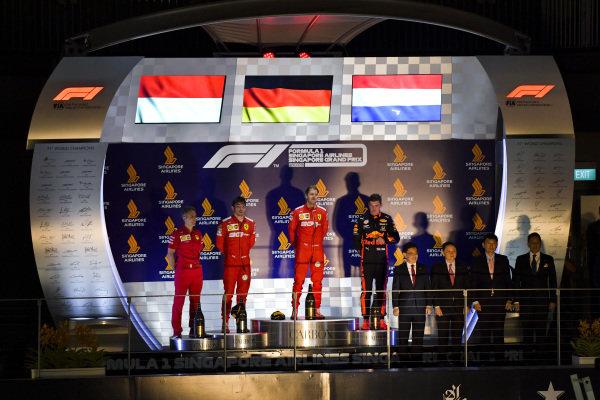 Charles Leclerc, Ferrari, Race winner Sebastian Vettel, Ferrari and Max Verstappen, Red Bull Racing on the podium