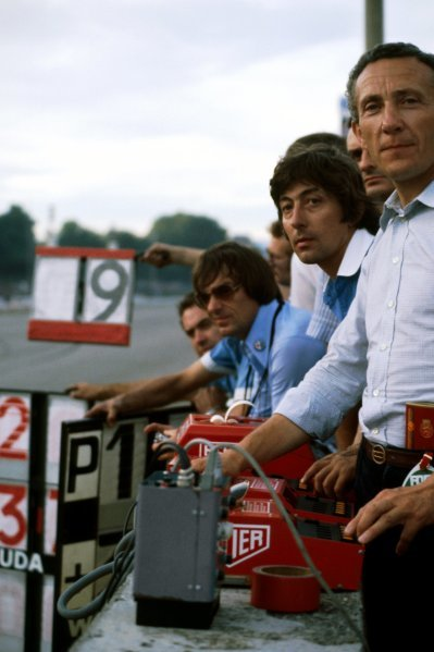 Herbie Blash (GBR) Brabham Team Manager (Centre) and Bernie Ecclestone (GBR) Brabham Team Owner (Left) watch Brabham drivers Niki Lauda (AUT) and John Watson (GBR), finish in first and second position from the pit wall.
