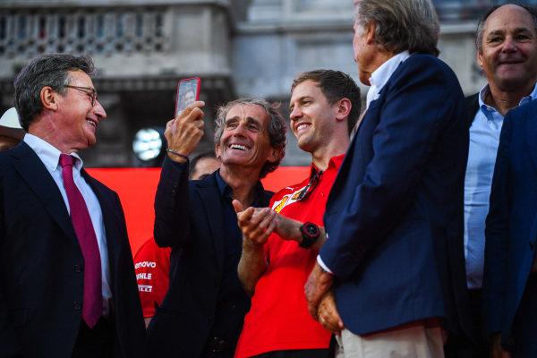 Alain Prost takes a selfie with Sebastian Vettel, Ferrari