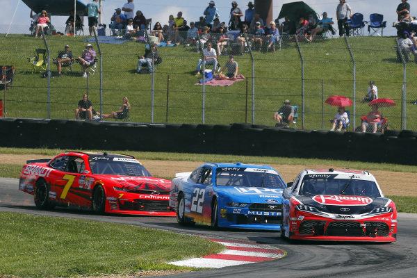 #20: Christopher Bell, Joe Gibbs Racing, Toyota Supra Rheem and #22: Austin Cindric, Team Penske, Ford Mustang PPG