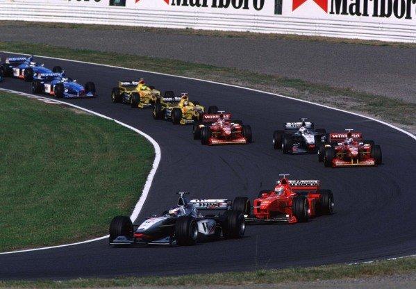 Japanese Grand Prix.Suzuka, Japan.30/10-1/11 1998.Mika Hakkinen (McLaren MP4/13 Mercedes-Benz) leads Eddie Irvine (Ferrari F300) and Heinz-Harald Frentzen (Williams FW20 Mecachrome) at the start. Hakkinen finished in 1st position clinching the World Championship.World Copyright - LAT Photographic