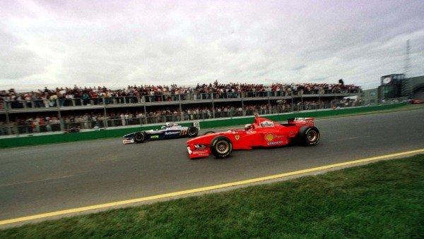 1997 Australian Grand Prix.Albert Park, Melbourne, Australia.7-9 March 1997.Michael Schumacher (Ferrari F310B) and Heinz-Harald Frentzen (Williams FW19 Renault).World Copyright - LAT Photographic