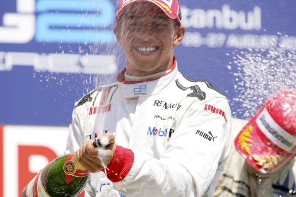 2006 GP2 Series. Round 10. Istanbul Park, Istanbul Turkey. 27th August 2006. Sunday Race. Lewis Hamilton (GBR, ART Grand Prix) celebrates his second position on the podium. World Copyright: Lorenzo Bellanca/GP2 Series Media Service. ref: Digital Image ZD2J8642