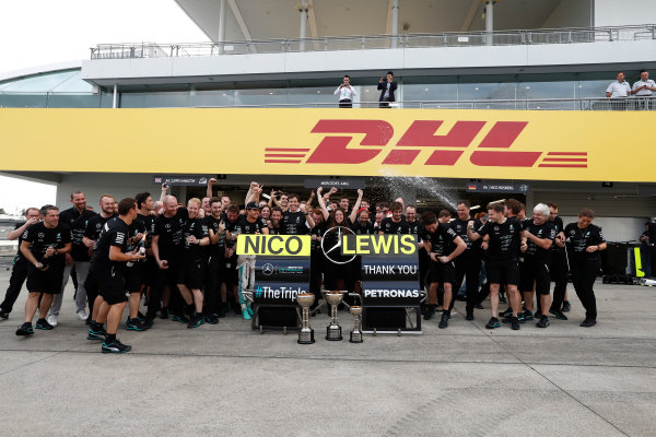 Suzuka Circuit, Japan. Sunday 9 October 2016. The Mercedes AMG team celebrate securing their 3rd consecutive constructors title. World Copyright: Dunbar/LAT Photographic ref: Digital Image _X4I8639