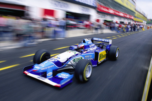 Michael Schumacher, Benetton B195 Renault, in the pits.