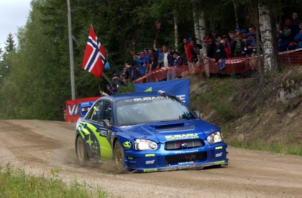 Petter Solberg (NOR) lands heavily in his Subaru Impreza WRC 2003.