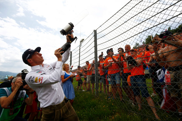 Red Bull Ring, Spielberg, Austria. Sunday 09 July 2017. Max Verstappen, Red Bull Racing, shoots T-shirts into a crowd of fans. World Copyright: Andy Hone/LAT Images ref: Digital Image _ONY2436